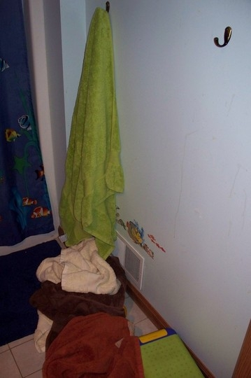 towel hanging, still one on floor