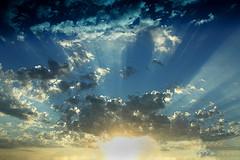 sun's rays shooting through clouds