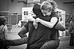 woman jumping joyfully into a man's arms
