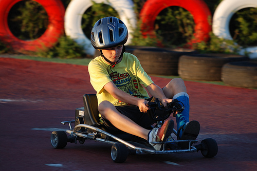 boy riding on go cart