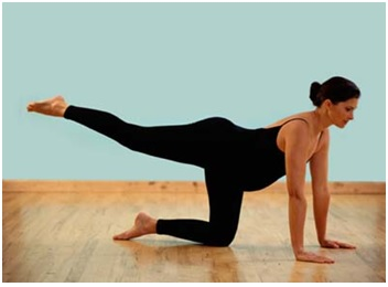 pregnant mom doing yoga