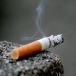smoking cigarette laying on ledge